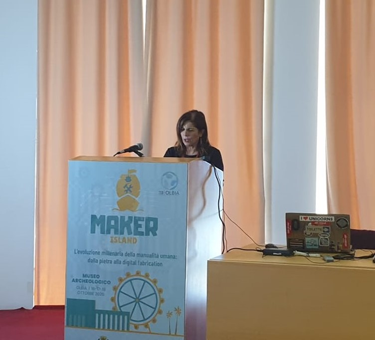 The picture shows a woman presenting at the event.