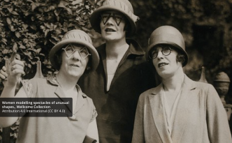 black and white photography of three women looking in the same direction